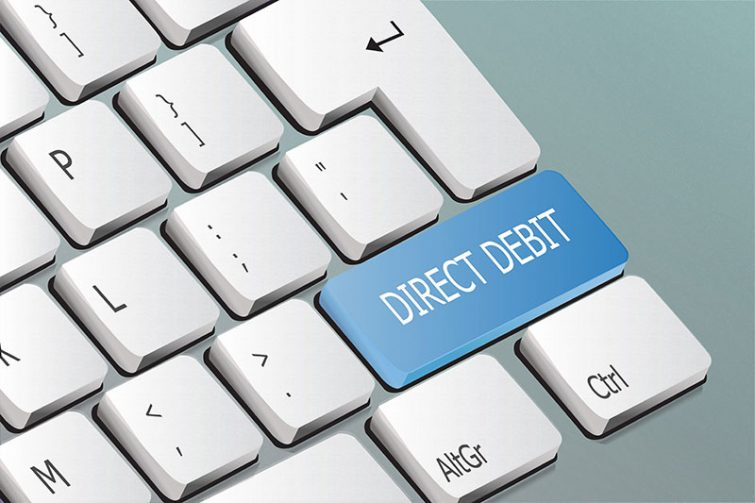 What is direct debit and how can it help businesses grow and achieve consistent cash flow?